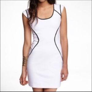White Dress with black outline.